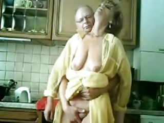 se mum and daddy having fun in the kitchen.