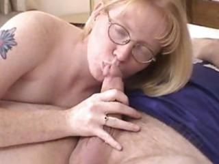blond mother i wearing glasses blows and drilled
