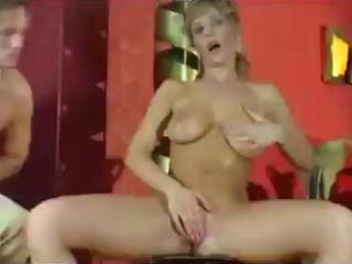 busty blonde milf gives a boob job and tugjob to