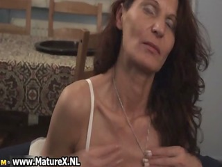 horny mature woman squeezes