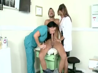 dressed male doctor and nurse give head