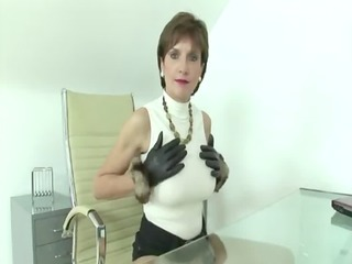 Mature fetish slut Lady Sonia tugs cock