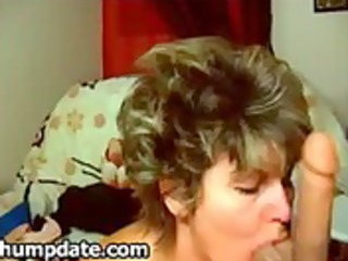 sexy mature playgirl deepthroats her large fake