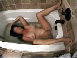 my mum in washroom tube masturbating with water