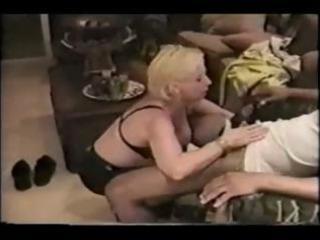 aged blonde slurps his dark cock and then gets