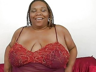 chunky ebony momma with huge bosom plays with her