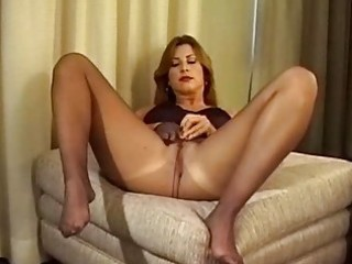 milf widens her legs and shows butt