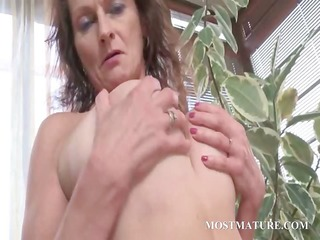 bare cougar works tits and unshaved cunt