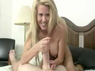 this slut lends him a hand with his erection to