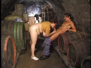 older big beautiful woman boned in the wine cellar